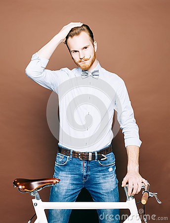 Free A Young Man With Mustache And Beard Is Near Fashionable Modern Fixgear Bicycle. Smooth Hair On The Head. Jeans And Shirt, The Bow Stock Photo - 63045950
