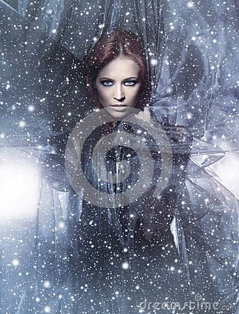 Free A Young Redhead Woman On A Snowy Background Royalty Free Stock Photography - 27818367