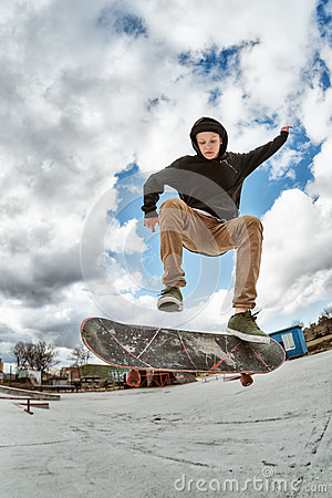 Free A Young Skateboarder Makes Wallie In A Skatepark, Jumping On A Skateboard Into The Air With A Coup Stock Images - 89181614