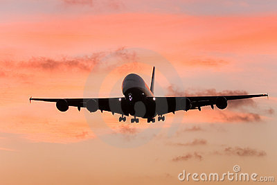 A380 airliner approaching landing at sunset