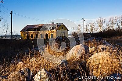 Abandon house behind rocks