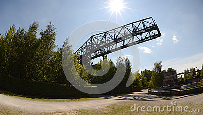 Abandoned bridge crane  in the sunshine