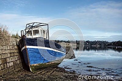 Abandoned Fishing Boat at Dock at Low Tide