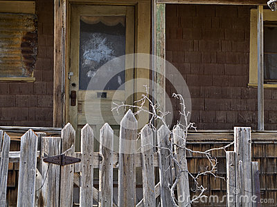 Abandoned house gate and front door