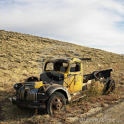 Abandoned old yellow pickup