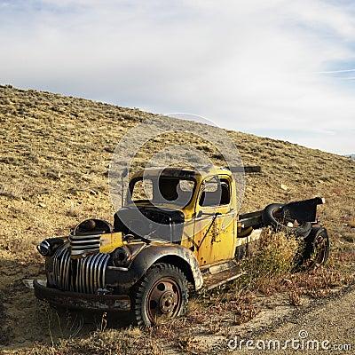 Abandoned old yellow pickup