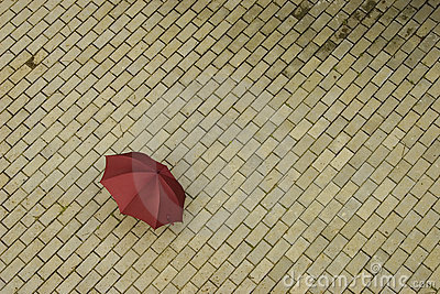 Abandoned red umbrella