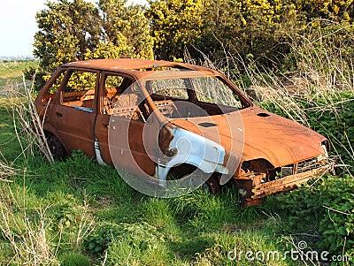 Abandoned rusty car wreck