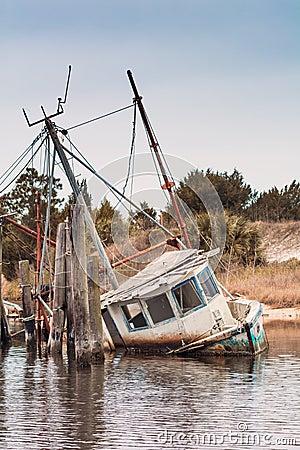 Free Abandoned Shrimp Boat Half Sunk Stock Photo - 51149600