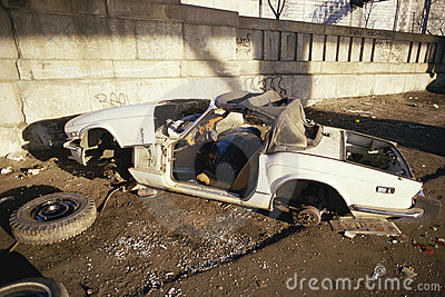 Abandoned trashed car