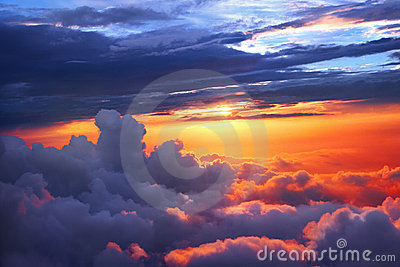 Above clouds sunset