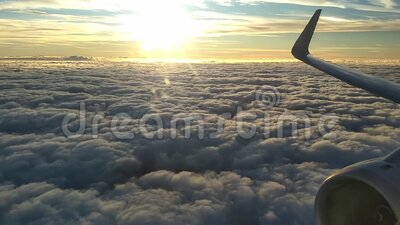 Above the Clouds. Traveling above the clouds on a commercial airliner in the morning shortly after sunrise stock video