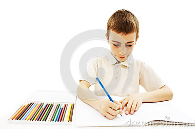 Absorbed little boy drawing with colorful pencils