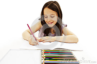Absorbed little girl drawing with colorful pencils