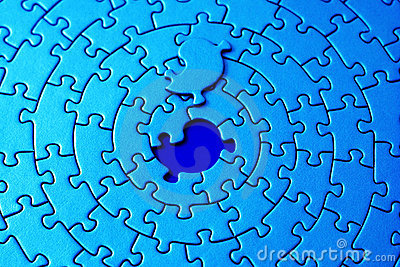 Abstract of a blue jigsaw with the missing piece laying above the space