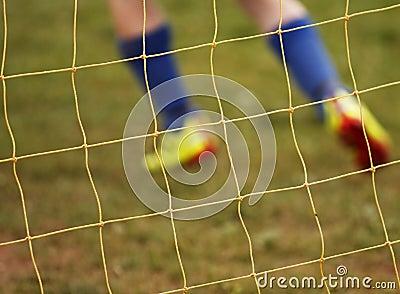 Abstract blur soccer net player