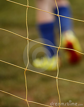Abstract blur soccer net player feet