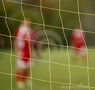 Abstract blur soccer net players