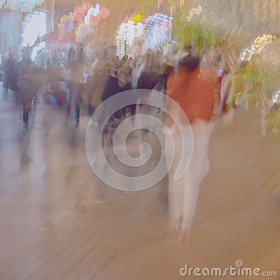 Free Abstract Blurred Image Of Unrecognizable Silhouettes Of People Walking In City Street In Evening, Shopping. Urban Modern Stock Photography - 103154242