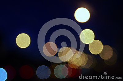 City lights abstract circular bokeh on a blue background. Stock Photo
