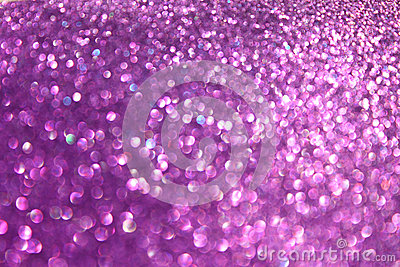 Abstract glitter purple lights background