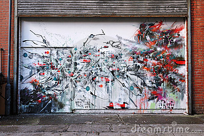 Abstract Graffiti Art on a Building Entrance Editorial Stock Photo