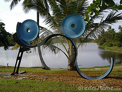 Abstract sculptures by lake