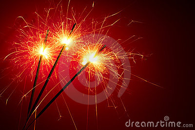 Abstract sparklers on red background