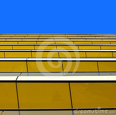 Abstract view of a yellow building against a summe
