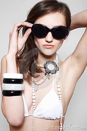 Accessory. Fashion woman in swimsuit & sunglasses