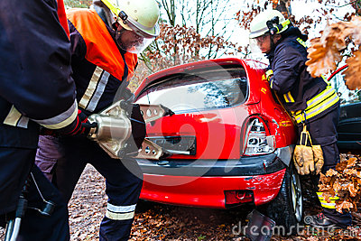 Accident - Fire brigade rescues Victim of a car crash