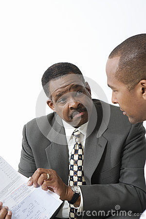Accountant And Client Going Over Bills