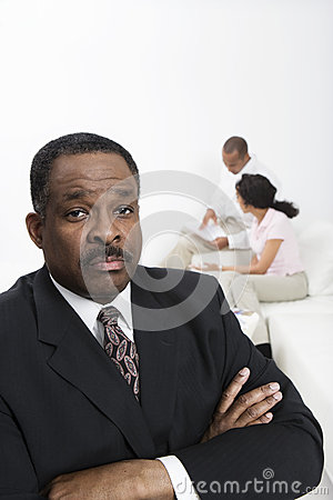 Accountant With Couple In Background