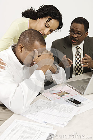 Accountant Giving Couple Bad News
