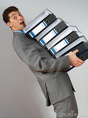 Accountant with pile of docume