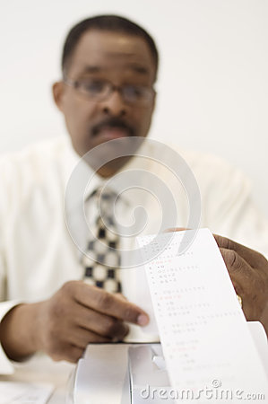 Accountant Reading An Adding Machine Tape