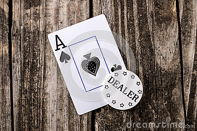 Ace of Spades Card on Wood