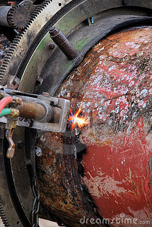 Acetylene torch and iron pipe