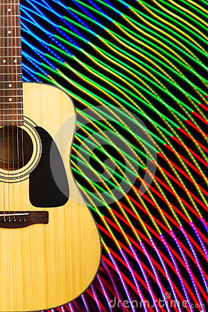 Acoustic guitar against abstract background
