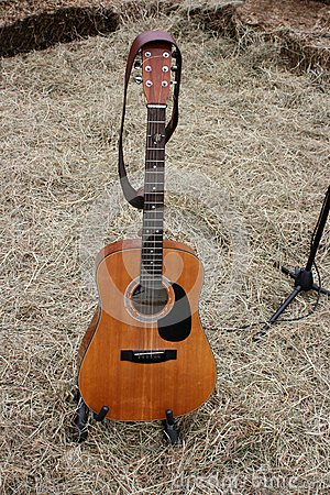 Acoustic Guitar and Straw on a farm