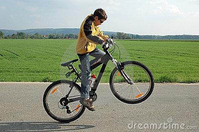 Acrobat on bicycle