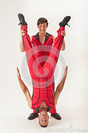Acrobat holding partner upside down