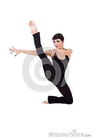 Acrobat makes splits jumping