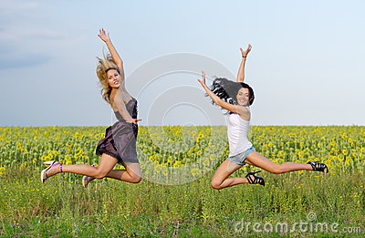 Acrobatic women leaping in unison