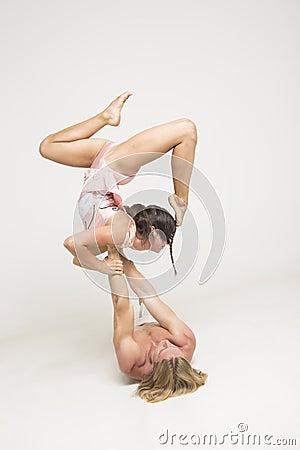 Acrobats perform as a team