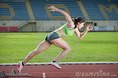 Action packed image of a female sprinter