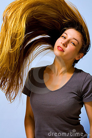 Active beautiful woman with long moving hair