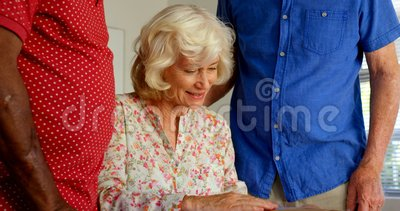 Active Caucasian senior people looking at photo album in nursing home 4k. Active Caucasian senior people looking at photo album in nursing home. They are stock video