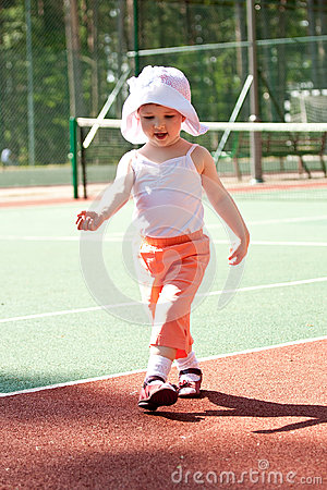 Active child walking in a stadium