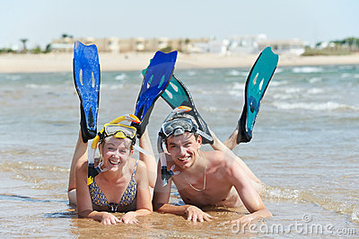 Active couple at sea beach with snorkel  set
